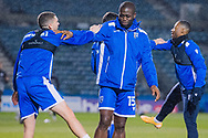 Smiles all round from Gillingham FC forward John Akinde (15) as he warms up before the EFL Sky Bet League 1 match between Gillingham and Crewe Alexandra at the MEMS Priestfield Stadium, Gillingham, England on 26 January 2021.