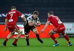 Olly Cracknell of Ospreys under pressure from Hadleigh Parkes of Scarlets<br /> <br /> Photographer Simon King/Replay Images<br /> <br /> Guinness PRO14 Round 11 - Ospreys v Scarlets - Saturday 22nd December 2018 - Liberty Stadium - Swansea<br /> <br /> World Copyright © Replay Images . All rights reserved. info@replayimages.co.uk - http://replayimages.co.uk