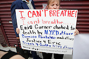 New York, NY- July 23: A Protestor attends the funeral of Eric Garner, who fell victim to the tactics of the NYPD after NYPD Officers rendered him in chokehold on July 20, 2014 in Staten Island. His funeral was held on July 23, 2014 at Bethel Baptist Church in New York City.  (Terrence Jennings)