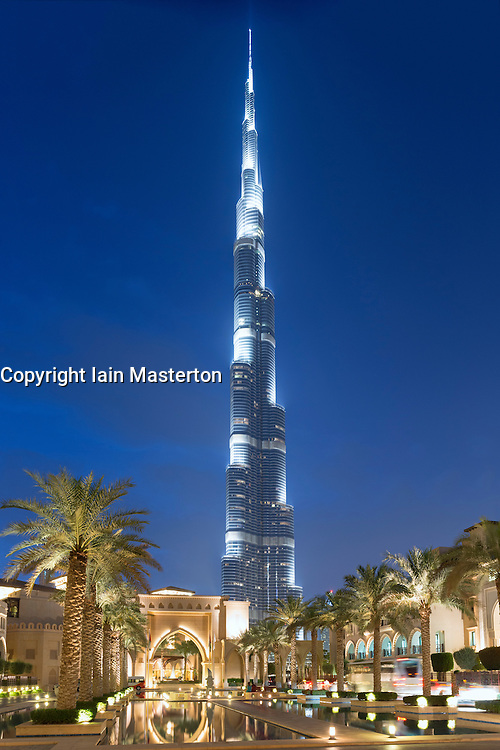 Evening view of Burj Khalifa skyscraper and entrance to Palace Hotel in Downtown Dubai district of Dubai United Arab Emirates