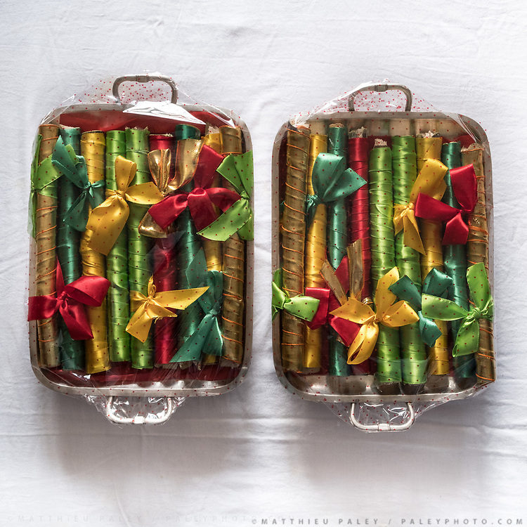 """Sugarcane sticks wrapped in colorful silk cloth. Traditional wedding gifts are prepared by the grrom's family for the bride. <br /> Called """"Saipata"""", they come in pairs as it is considered auspicious."""