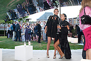 HANNAH BHUIYA; NOEMIE SAGLIO, 2009 Serpentine Gallery Summer party. Sponsored by Canvas TV. Serpentine Gallery Pavilion designed by Kazuyo Sejima and Ryue Nishizawa of SANAA. Kensington Gdns. London. 9 July 2009.