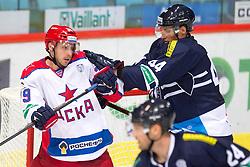 Jan Mursak of CSKA Moscow vs Branislav Mezei of KHL Medvescak Zagreb during KHL League ice hockey match between KHL Medvescak Zagreb and CSKA Moscow, on September 18, 2014 in Dvorana Sportova, Zagreb, Croatia. (Photo By Matic Klansek Velej / Sportida)