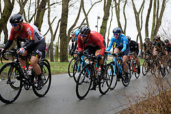 Peloton charge through the trees at Driedaagse Brugge - De Panne 2018 - a 151.7 km road race from Brugge to De Panne on March 22, 2018. Photo by Sean Robinson/Velofocus.com