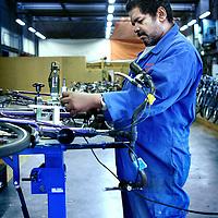 Nederland, Amsterdam , 14 november 2011..Robbie met z.g. verstandelijke beperking,  een afstand tot de arbeidsmarkt',is werkzaam bij het fietsdepot op Bornhout 8..Foto:Jean-Pierre Jans