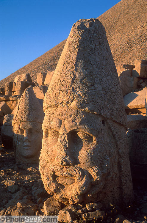 "A six-foot tall head of Zeus commemorates the lofty aspirations of pre-Roman King Antiochus (64-38 BC) at Mount Nimrod (Nemrut Dagi in Turkish), near Malatya, Turkey. Earthquakes toppled the stone heads from seated bodies long ago, but Mount Nemrut National Park may restore the site. Published in Wilderness Travel 2003 Catalog of Adventures, and in Sierra Magazine, Sierra Club Outings January/February 2001. Published in ""Light Travel: Photography on the Go"" book by Tom Dempsey 2009, 2010."
