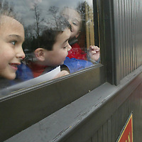 (PSUNDAY) Wall Twp 11/30/2002 L-R Thomas DiBella 7 1/2, Thomas Ridgway 6 and Andrew DiBella 3 1/2 look out the window in anticipation of Santa coming  aboard the Pine Creek Railroad train train ride with him.    Michael J. Treola Staff Photographer