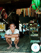A man in his store in the floating village of Kompong Phluk on the great Tonlé Sap lake, Cambodia