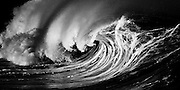 High contrast of the powerful shorebreak wave at Waimea Bay on Oahu's North Shore, Hawaii