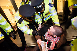 © licensed to London News Pictures. London, UK. 15/02/12. Police attempt to remove protestors from hotel entrance. Electricians from Balfour Beatty Engineering Services (BBES) & activists hold a demonstration outside of the Electrical Contractors Association dinner at the Grosvenor Hotel in London, causing serious traffic disruption on Park Lane. On 2 February Unite members at Balfour Beatty Engineering Services (BBES) voted for a second time to strike over what they claim is the termination of long-held agreements and the de-skilling of construction workers.   Photo credit: Jules Mattsson/LNP