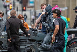 30JUL21 A Batman body double drives the Batcycle down St Vincent Street in Glasgow as filming of The Flash on Friday afternoon.