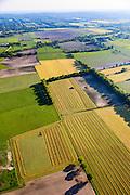 Nederland, Utrecht, Utrechtse Heuvelrug, 27-05-2013; buurtschap en buitengebied De Groep.  Maaien van gras geeft patronen.<br /> Tijdens de Tweede Wereldoorlog lag de Grebbelinie in dit gebied met oorlogsschade aan boerderijen en landerijen als gevolg. Herstel en ruilverkaveling na de oorlog, wederopbouwgebied.<br /> The Grebbe Line (defense linein World War II ) ran through this area. After the war repair of destroyed farm lands and farms took place  as well as land consolidation in the context of the Reconstruction.<br /> luchtfoto (toeslag op standard tarieven)<br /> aerial photo (additional fee required)<br /> copyright foto/photo Siebe Swart