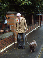 British Labour Party politician Michael Foot seen walking his near his home in London in 1983.
