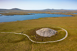 Aerial view from drone of the best preserved Neolithic chambered cairn in the Outer Hebrides at Langass on North Uist, Outer Hebrides, Scotland, UK