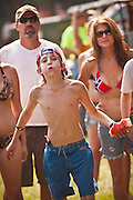 Young participant in the watermelon seed spiting contest during the annual Summer Redneck Games Dublin, GA.