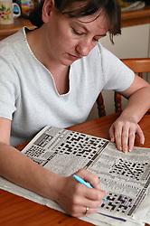 Woman doing a crossword,