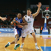 Anadolu Efes's Dontaye Draper (L) and Nizhny Novgorod's Gal Mekel (R) during their Turkish Airlines Euroleague Basketball Top 16 Round 11 match Anadolu Efes between Nizhny Novgorod at Abdi ipekci arena in Istanbul, Turkey, Thursday March 19, 2015. Photo by Aykut AKICI/TURKPIX