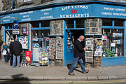 Townsfolk walk past the newsagents and gift shop on Eldon Square, on 12th September 2018, in Dolgellau, Gwynedd, Wales.