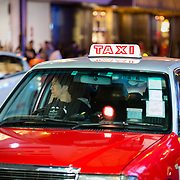 Taxi driver waiting for a fare in Hong Kong