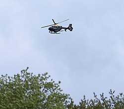 A police helicopter flew low over the trees in Almondell Country Park, East Calder, West Lothian this afternoon.<br /> <br /> It's thought it was taking part in a search for missing person 37-year-old Kelly Johnson from Elm Grove, Livingston who has been missing from her home since Tuesday 30th April.<br /> <br /> Pictured: Police helicopter<br /> <br /> Alex Todd | Edinburgh Elite media
