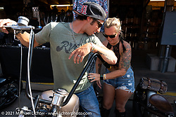 Jeremy Kramer and his 1974 CB-750 that won the metric class in the Dennis Kirk Garage Build bike show. Iron Horse Saloon during the Sturgis Motorcycle Rally. SD, USA. Tuesday, August 10, 2021. Photography ©2021 Michael Lichter.
