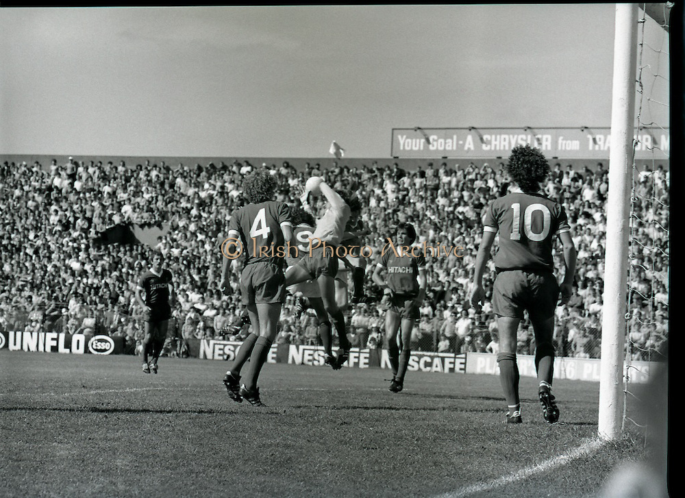 League of Ireland vs Liverpool FC.    (M87)..1979..18.08.1979..08.18.1979..18th August !979..In a pre season friendly the League of Ireland took on Liverpool FC at Dalymount Park Phibsborough,Dublin. The league team was made up of a selection of players from several League of Ireland clubs and was captained by the legendary John Giles. Liverpool won the game by 2 goals to nil..The scorers were Hansen and McDermott...Ray Clemence is pictured taking the ball in the air following a corner kick