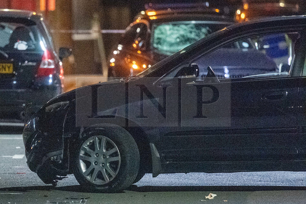 © Licensed to London News Pictures. 20/07/2020. London, UK. A damaged vehicle sits on Scott Street inside a police cordon. An investigation has been launched after a person was rammed by a car in Bethnal Green, the person was rammed by the vehicle into a fence. Photo credit: Peter Manning/LNP