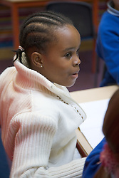 Primary school pupil concentrating in a lesson at school,