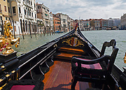 Detail photo of the front of a gondola on the Grand Canal, Venice
