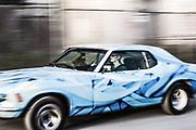 Automotive photographer Raymond Rudolph photographs a cool paint job in motion