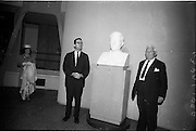 07/06/1964<br /> 06/07/1964<br /> 07 June 1964<br /> Bust of President Kennedy unveiled at the American Embassy, Dublin. A bust of the late President John F. Kennedy was unveiled by Mrs Ted Sorensen, in the presence of the retiring American Ambassador to Ireland, Mr. Matthew McCluskey. The bust was set in the main hall of the new United States Embassy, Ballsbridge. Mrs Sorensen was the four day bride of Mr. Ted Sorensen, who was a special aide to the late President. Image shows (l-r): Mrs Sorensen; Mr. Sorensen and Ambassador McCluskey.