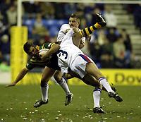 Photo. Aidan Ellis.<br />Great Britan v Australia.<br />1st Test Match at JJb Stadium Wigan.<br />8/11/2003.<br />Great Britain's Brian Carney and Terry Newton combine to halt an Australioan attack