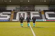 The Match referee and his 2 assistants head out to warm up ahead of the U17 European Championships match between Scotland and Russia at Simple Digital Arena, Paisley, Scotland on 23 March 2019.