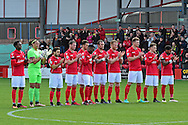 Ebbsfleet team pay tribute to former Fleet skipper Paul McCarthy during the Vanarama National League South match between Ebbsfleet United and East Thurrock United at the Enclosed Ground, Whitehawk, United Kingdom on 4 March 2017. Photo by Jon Bromley.