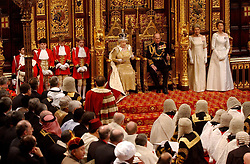File photo dated 23/11/04 of Queen Elizabeth II, with the Duke of Edinburgh, making her speech at the State Opening of Parliament in The House of Lords in London. The Royal couple will celebrate their platinum wedding anniversary on November 20.