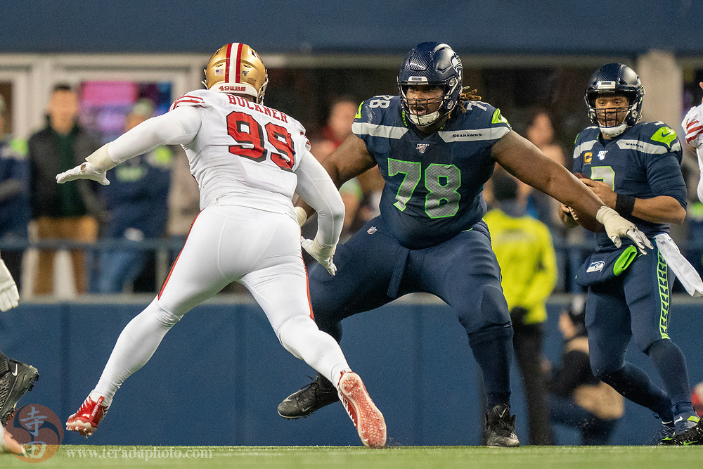 December 29, 2019; Seattle, Washington, USA; Seattle Seahawks offensive guard D.J. Fluker (78) blocks San Francisco 49ers defensive tackle DeForest Buckner (99) during the second quarter at CenturyLink Field.