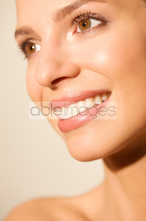 Close up portrait of a young woman smiling