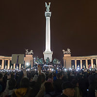 Participants hold their phones in the air to protest against the planned Internet tax on Heroes Square in Budapest, Hungary on October 26, 2014. ATTILA VOLGYI