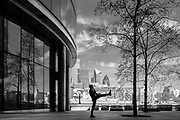 EDITORS NOTE: Image has been converted to black and white. Exercising outdoors, with the City of London in the background,  is deserted due to lockdown as a result of the Coronavirus Pandemic on 16th April 2020 in London, United Kingdom. Coronavirus or Covid-19 is a new respiratory illness that has not previously been seen in humans. Much of Europe has been placed into lockdown, with stringent rules in place as part of a long term strategy, and in particular social distancing, and a stay at home policy.