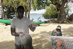 DAKAR, Feb. 10, 2014  Villagers weave a fishing net in a village of Jola people, in Casamance, southern Senegal, Feb. 4, 2014. The Jola (Diola, in French transliteration) is an ethnic group in Senegal, where they predominate in the region of Casamance. The Jolas are believed to have migrated to Casamance before the 13th century and kept a traditional lifestyle till now. (Xinhua/Tai Jianqiu) (Credit Image: © Xinhua via ZUMA Wire)