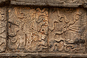 Tzompantli or Skull Platform in Chichen Itza. Displayed skeletonized warriors with arrows and shields snakes and serpents.
