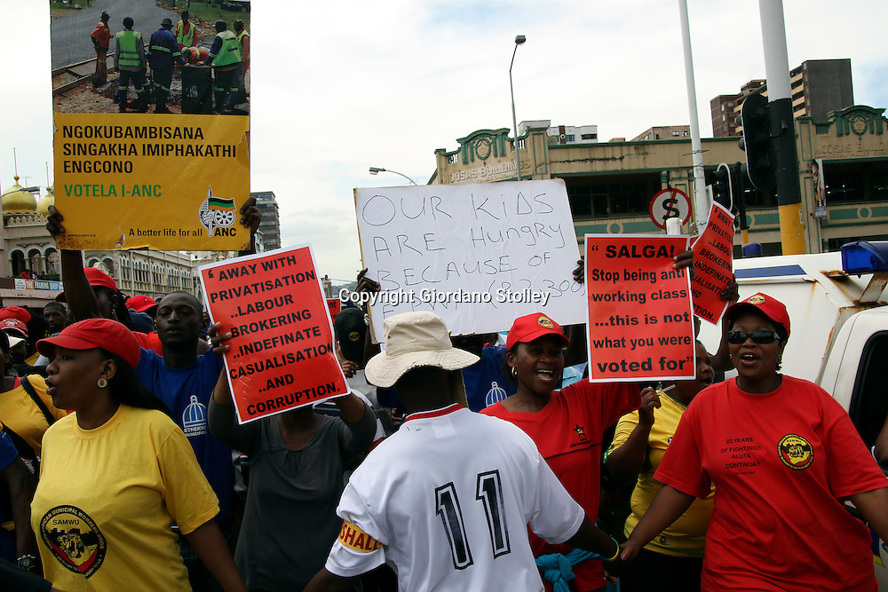 DURBAN - 26 October 2012 - SA Municipal Worker's Union members march through central Durban to demand that municipalities abandon ther appeal against a labour court ruling that upheld a wage curve agreement between the collective bargaining parties..Picture: Giordano Stolley/Allied Picture Press/APP