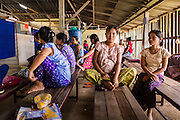 20 MAY 2013 - MAE KASA, TAK, THAILAND:  Women in the obstetrics waiting area at the SMRU clinic in Mae Kasa, Thailand. Health professionals are seeing increasing evidence of malaria resistant to artemisinin coming out of the jungles of Southeast Asia. Artemisinin has been the first choice for battling malaria in Southeast Asia for 20 years. In recent years though,  health care workers in Cambodia and Myanmar (Burma) are seeing signs that the malaria parasite is becoming resistant to artemisinin. Scientists who study malaria are concerned that history could repeat itself because chloroquine, an effective malaria treatment until the 1990s, first lost its effectiveness in Cambodia and Burma before spreading to Africa, which led to a spike in deaths there. Doctors at the Shaklo Malaria Research Unit (SMRU), which studies malaria along the Thai Burma border, are worried that artemisinin resistance is growing at a rapid pace. Dr. Aung Pyae Phyo, a Burmese physician at a SMRU clinic just a few meters from the Burmese border, said that in 2009, 90 percent of patients were cured with artemisinin, but in 2010, it dropped to about 70 percent and is now between 55 and 60 percent. He said the concern is that as it becomes more difficult to clear the parasite from a patient, progress that has been made in combating malaria will be lost and the disease could make a comeback in Southeast Asia.    PHOTO BY JACK KURTZ
