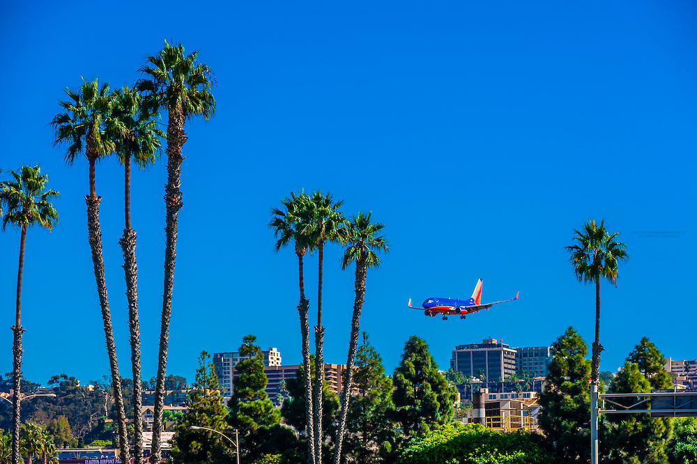 Low flying aircraft coming in to land at San Diego International Airport (Lindbergh Field), San Diego, California USA.