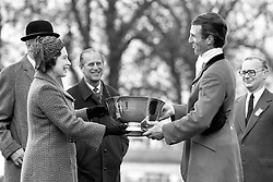 File photo dated 12/04/81 of the Duke of Edinburgh watching Queen Elizabeth II and their son-in-law Captain Mark Phillips at the presentation ceremony, after Phillips won the Badminton Horse Trials for the fourth time. The Royal couple will celebrate their platinum wedding anniversary on November 20.