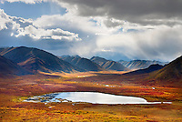 Stormy sky reflected in small lake, Tombstone Territorial Park Yukon Canada