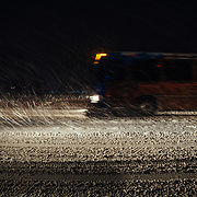 A bus waits at the light at the junction of Moose-Wilson Road and Highway 22 at the end of a day of skiing.