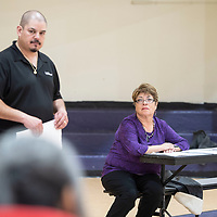 City Councilor Fran Palochak, right, holds a neighborhood meeting where Adrian Marrufo, left, a solid waste superintendent with the City of Gallup speaks to residents of the neighborhood, Thursday, April 11 at Tobe Turpen Elementary School.
