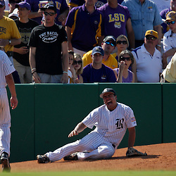06 June 2009: Rice third baseman Anthony Rendon (right) screams in pain after suffering a leg injury that knocked him out of the game in the top of the second inning, during game two of the NCAA baseball Super Regional between the Rice Owls and the LSU Tigers at Alex Box Stadium in Baton Rouge, Louisiana.