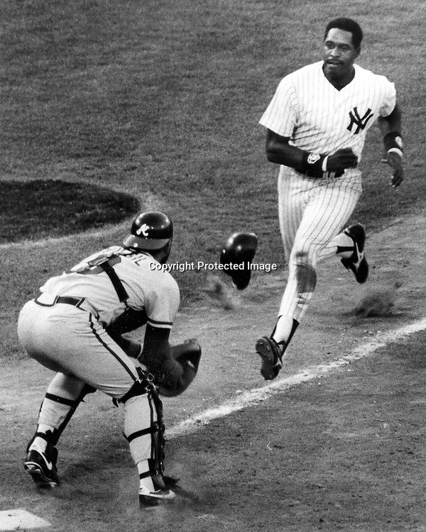 1987 All Star game: N.Y. Yankee's Dave Winfield is out at home tagged by Atlanta Brave's Ozzie Virgil Jr. <br />(1987 photo by Ron Riesterer)